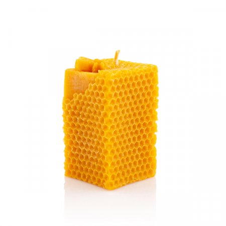 Honeycomb candle with a bee
